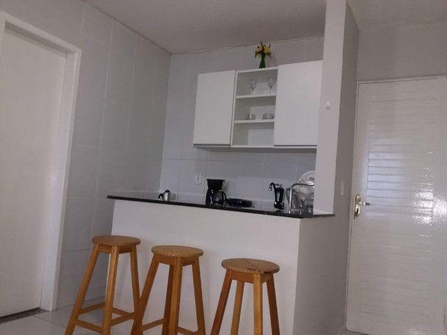 Vendo flat na frente da praia do coqueiro - Foto 9