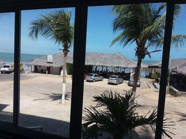 Vendo flat na frente da praia do coqueiro - Foto 11