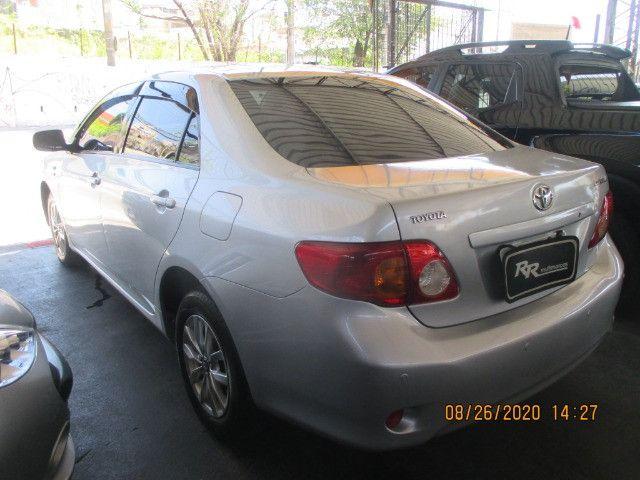 Corola xli 1.6 ano 2009 - Foto 13