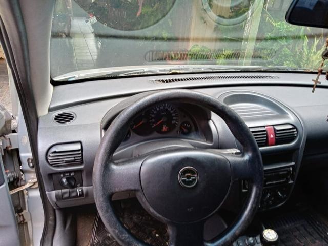 Vendo corsa sedan 1.0 completo - Foto 3