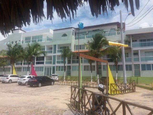 Vendo flat na frente da praia do coqueiro - Foto 14