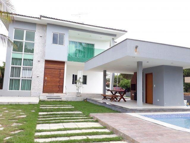 Casa moderna com área de lazer privativa em condomínio fechado   Oficial Aldeia Imóveis