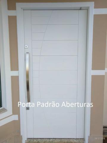 Porta Pivotante de madeira maciça Alto Padrão - Foto 6