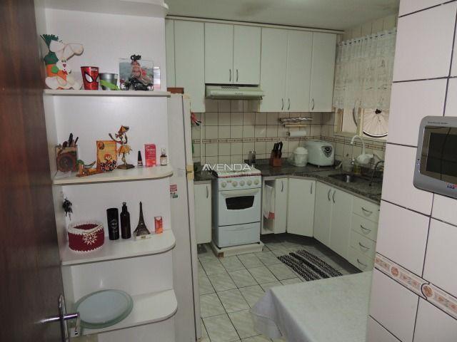 Casa térrea em ótima localização, contendo 3 dormitórios sendo 01 suíte - Foto 19