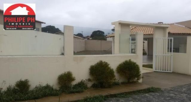 Terreno com r.g.i e projeto aprovado em condomínio de casas! - Foto 2