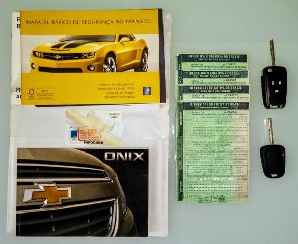 Onix LT 2013, 1.0 completo, novíssimo, tudo pago 2020! - Foto 20