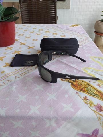Vendo lindo oculos de sol Mormaii Acqua produto novo e original completo - Foto 6