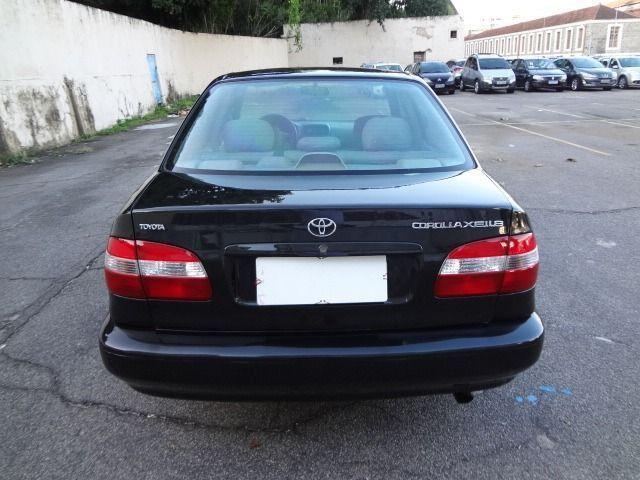 Toyota corolla xei 1.8 automático preto completo com gnv - Foto 6