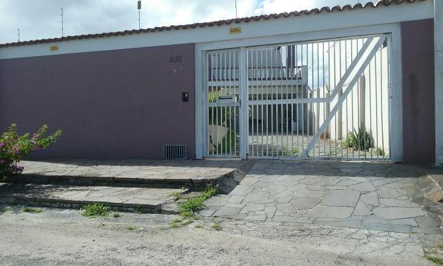 Casa com piscina próxima ao fórum
