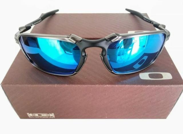 e5662ab6ed7ec Óculos de Sol Oakley Badman com Lentes polarizadas e com proteção uva e uvb  400 garantido