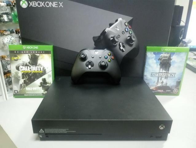 Xbox One X - Com garantia de 01 ano. Aceitamos video games como parte do pagamento