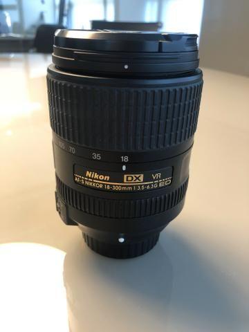 Nikon D7100 + Lente Nikor 18-300 + adaptador Wi-Fi + Carregador + Mochila - Foto 6