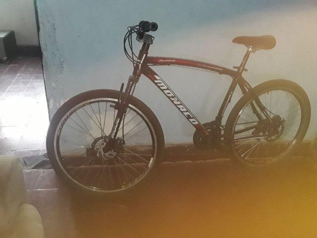 Bicicleta e suporte