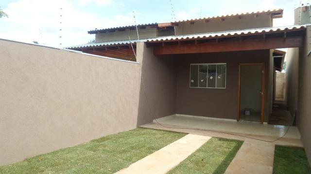 Linda casa com excelente acabamento muito espaço