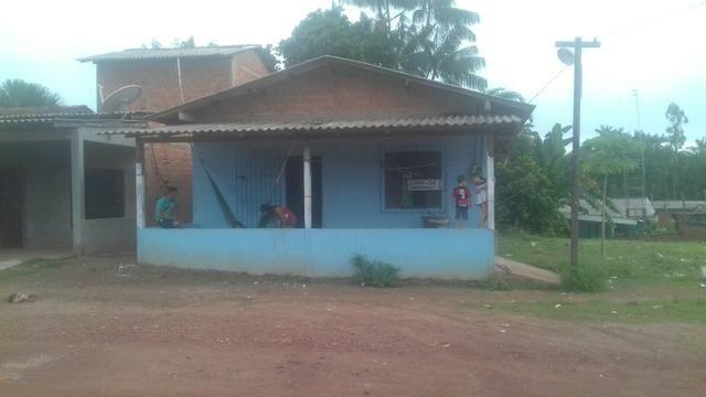 Casa e terrenos