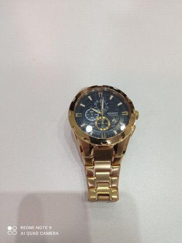 Relógio Orient novinho banhado a ouro  - Foto 2