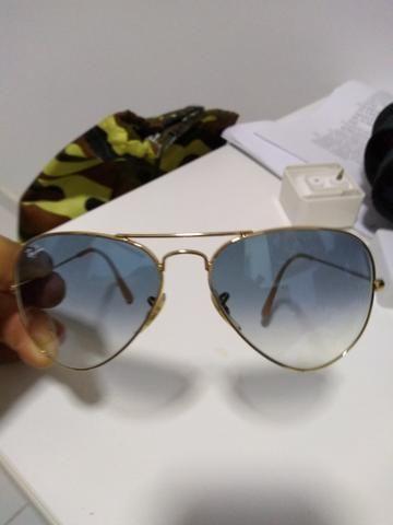 b203ef570 Óculos Rayban armação dourada lente azul - Bijouterias, relógios e ...