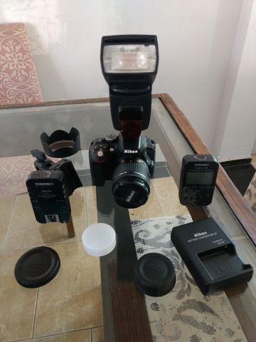 Câmera Nikon D5300 + Lente 18-55mm + Flash + Mochila + Radio flash - Foto 6