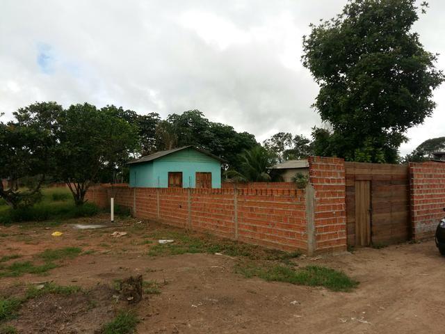 Terreno com uma casa, localizado no marabaixo IV, todo murado