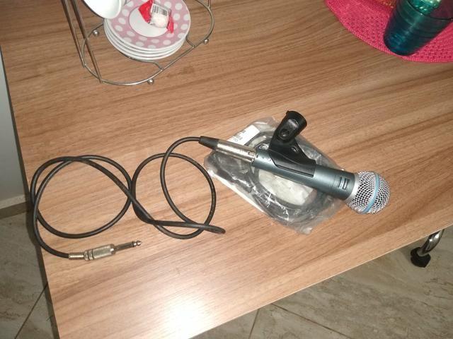 Vendo microfone shure 58 a novinho sem detalhes quem vê compra
