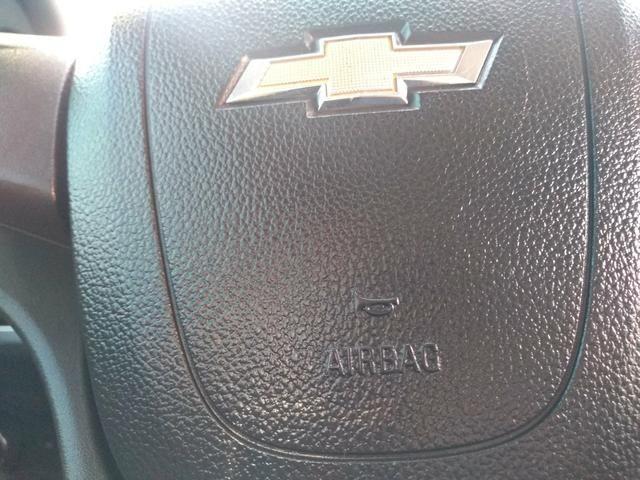 Onix LT completo abaixo tabela pneus okm air bag abs revisado garantia - Foto 9