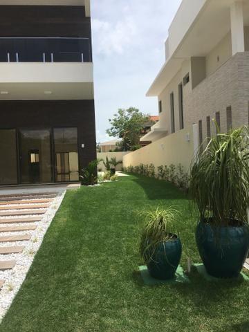 Casa 4 suítes Alphaville Eusébio 450 m2