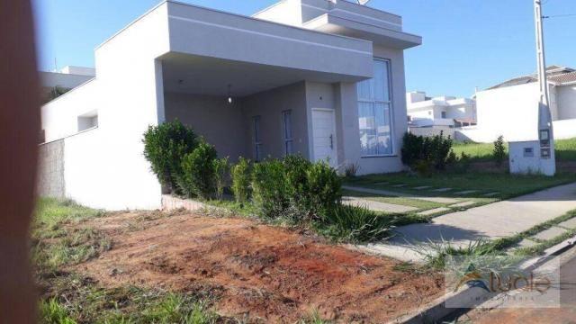 Casa com 3 dormitórios para alugar, 195 m² por R$ 2.605,00/mês - Residencial Real Parque S