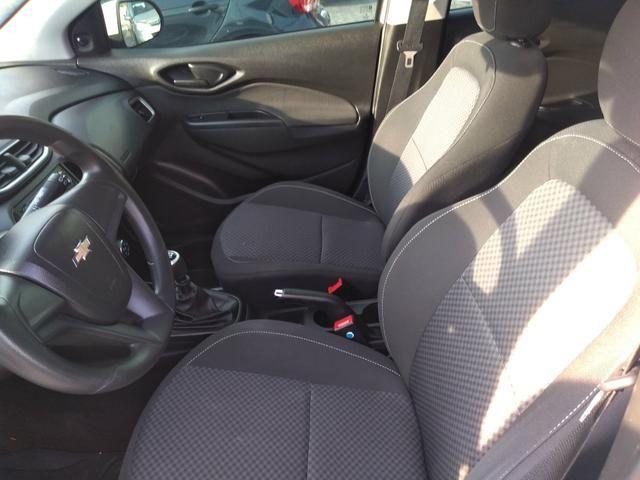 Onix LT completo abaixo tabela pneus okm air bag abs revisado garantia - Foto 2