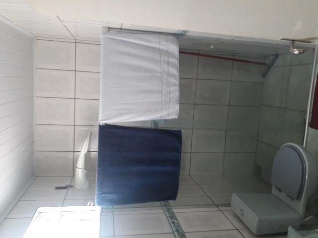 Suíte para solteiro(a) em casa ampla na zona sul, incluso água (dividir aluguel) - Foto 10