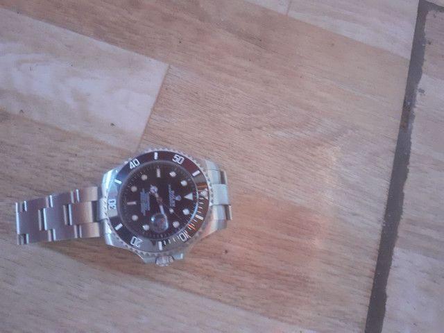 Rolex prata, com marcar de uso