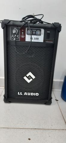 Caixa de som multiuso + cabo auxiliar