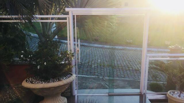 Telhado de vidro, portas de correr e muito mais