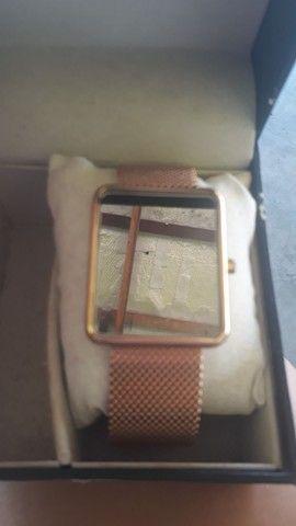 Vendo relógio tipo espelho digital...