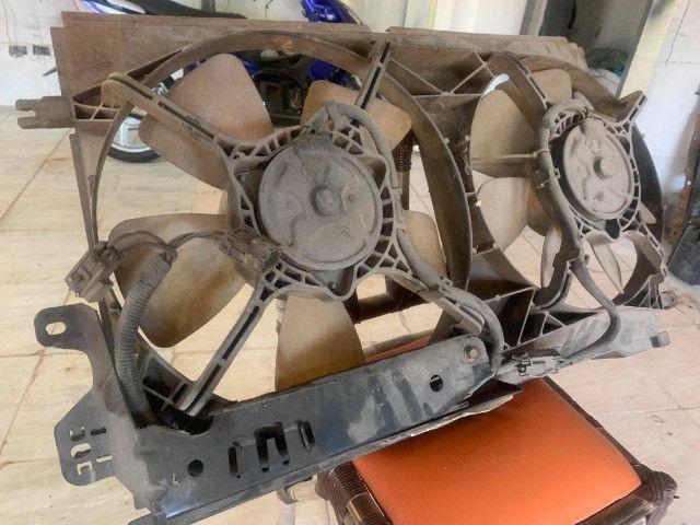 compressor ventoinhas e bomba de direcao omega australano - Foto 7