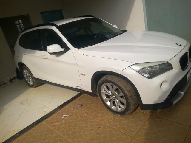 Vendo ou troco em carro de menor valor BMW X1 sdrive 2.0 18i 4x2 2011 completa - Foto 3