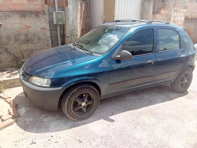 Celta -2003 vhc 4 portas banco de couro aro 14 vendo 10 mil ou troco por carro sedan - Foto 3