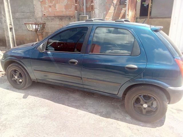 Celta -2003 vhc 4 portas banco de couro aro 14 vendo 10 mil ou troco por carro sedan