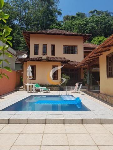 Casa com 4 dormitórios à venda, 500 m² por R$ 1.580.000 - Quarteirão Brasileiro - Petrópol
