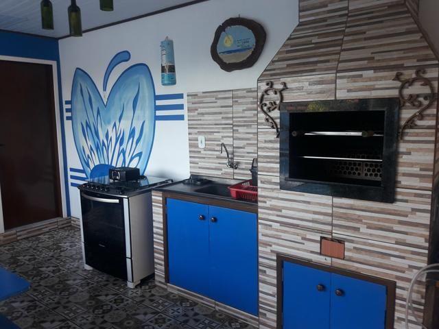 Casa com Piscina Confortável em Ótima Localização - Foto 12