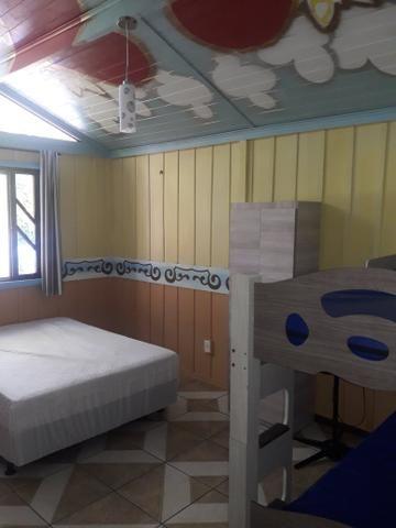 Casa com Piscina Confortável em Ótima Localização - Foto 6