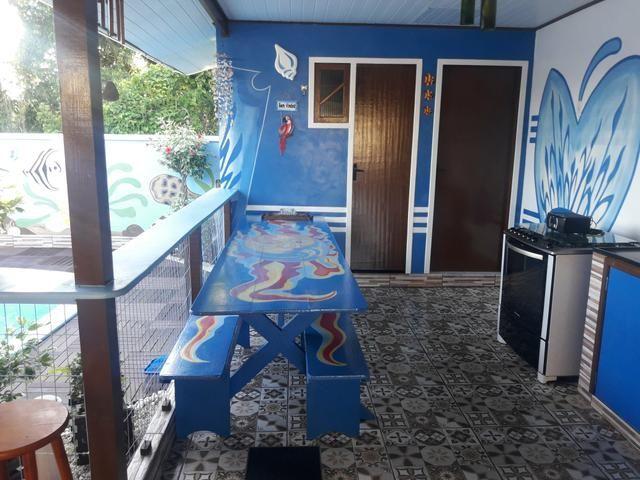 Casa com Piscina Confortável em Ótima Localização - Foto 13