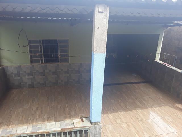 Vendo lote com casa nos fundos e construção na frente