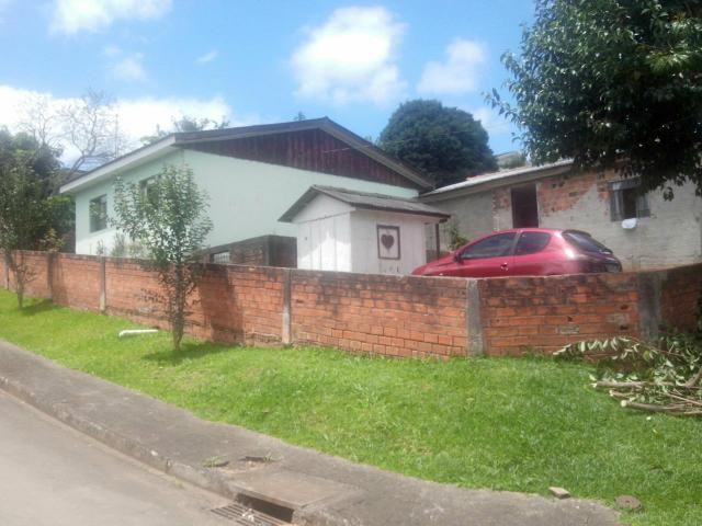 Terreno de esquina no bairro meraluz com duas casa area total 374m