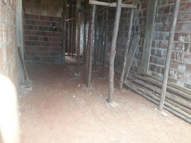 Vendo lote com casa nos fundos e construção na frente - Foto 13