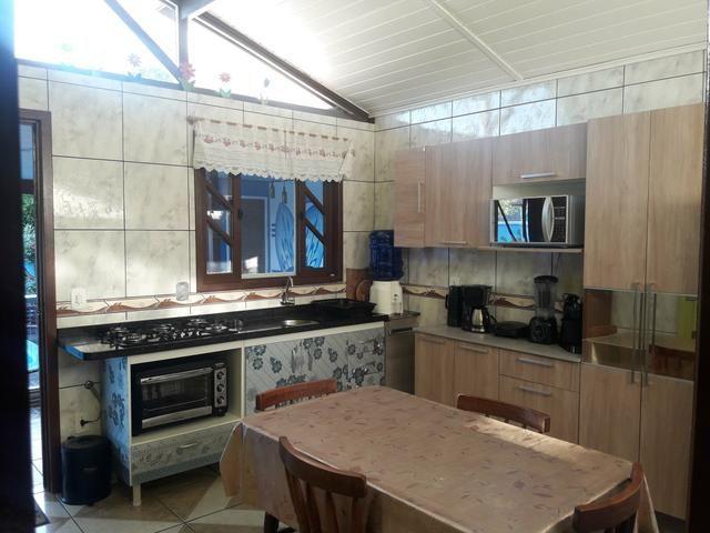 Casa com Piscina Confortável em Ótima Localização - Foto 10