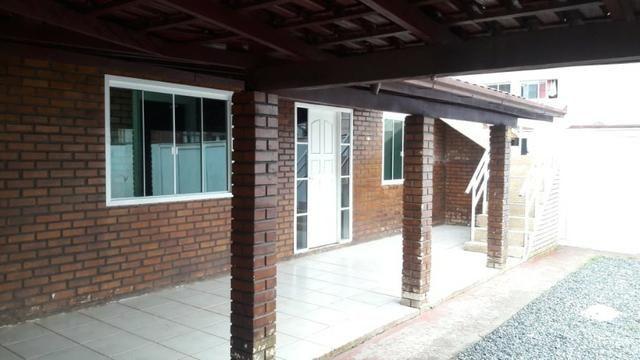 Locação anual Aparamento térreo 02 dormitórios com 01 vaga de estacionamento
