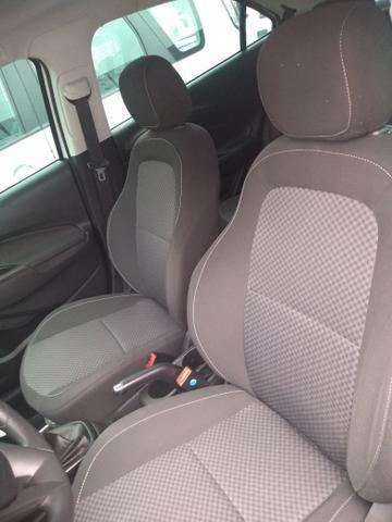Onix LT completo abaixo tabela pneus okm air bag abs revisado garantia - Foto 20