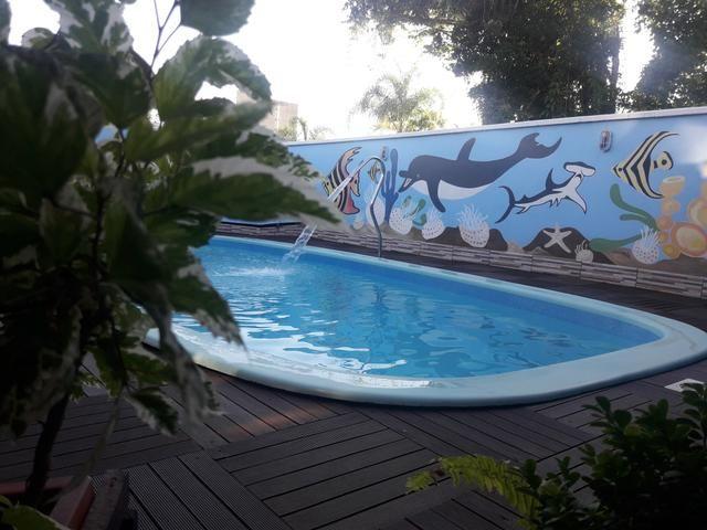Casa com Piscina Confortável em Ótima Localização - Foto 16