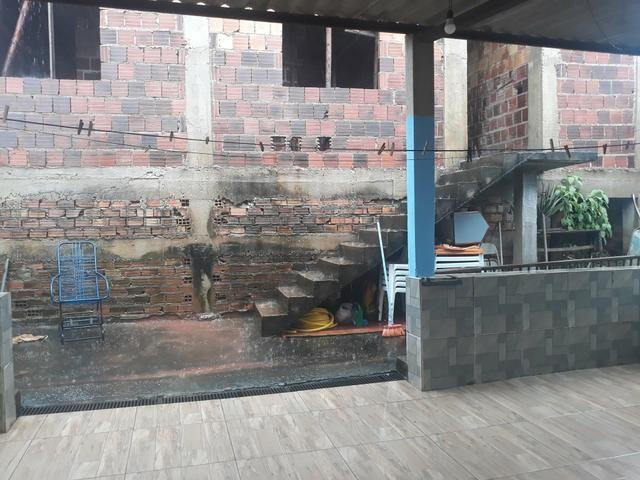 Vendo lote com casa nos fundos e construção na frente - Foto 11