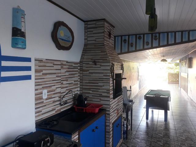 Casa com Piscina Confortável em Ótima Localização - Foto 15